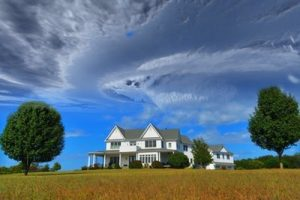 Your hurricane damage insurance claim is safe in our hands – your property, such as this house on a field will be reimbursed.