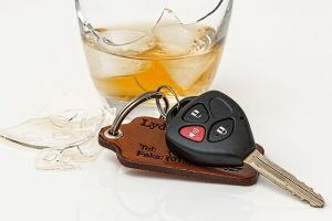 Glass of whiskey next to car keys - don't drink and drive!