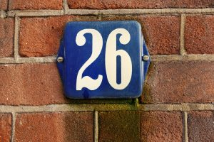 A brick wall with the number 26 on it