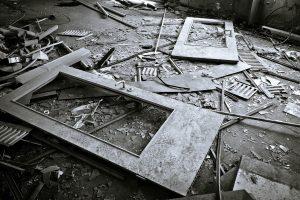 Broken doors and glass laying on the floor