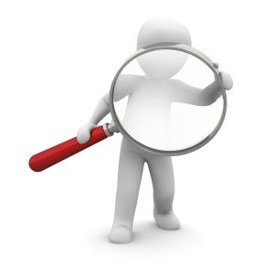 A fire damage adjuster with a magnifying glass, white background