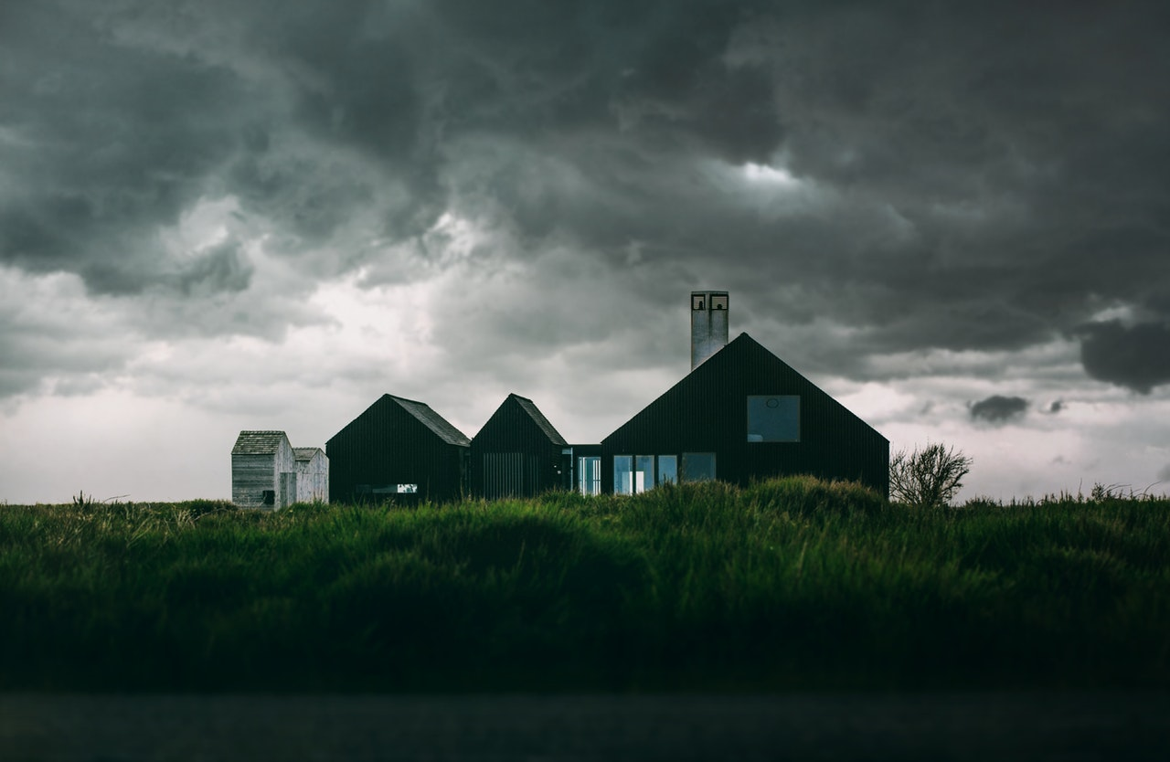 A house and a dark, stormy sky