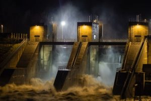 Flooding can tear down objects much stronger than an average house, such as this dam.