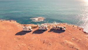 Caravans parked on a cliff next to the sea
