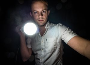 Man holding a flashlight