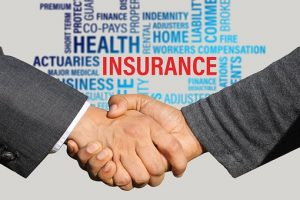 people shaking hands after the purchase of transportation insurance