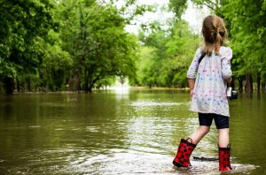 Child looking at flood and learning how to react to in-house flooding