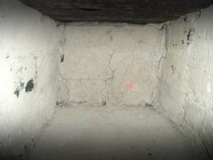 Cracks on basement walls you should fill with the cement to waterproof your basement