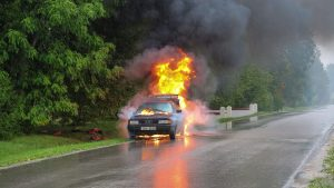 A car exploding by the side of the road; a reason to file a vandalism insurance claim.