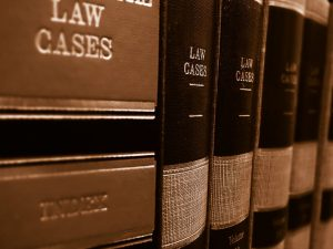 A row of legal books with law cases.