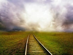 A storm going down a railroad.