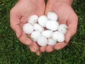 hail damage insurance claim - hailstones in hands